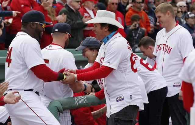 Boston Red Sox's David Ortiz greets Carlos Arredondo, center, and other victims of the Boston Marathon bombing and their family members during pre-game ceremonies before a baseball game against the Milwaukee Brewers on Opening Day at Fenway Park in Boston, Friday, April 4, 2014. (AP Photo/Michael Dwyer)