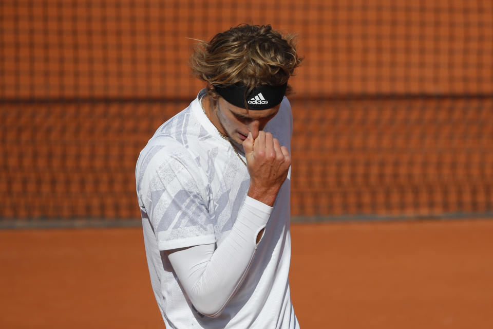 Germany's Alexander Zverev reacts after missing a shot against Italy's Jannik Sinner in the fourth round match of the French Open tennis tournament at the Roland Garros stadium in Paris, France, Sunday, Oct. 4, 2020. (AP Photo/Christophe Ena)