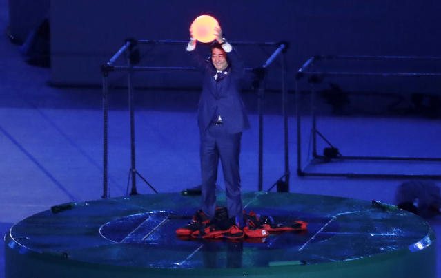 <p>Japanese Prime Minister Shinzo Abe appears during the closing ceremony in the Maracana stadium at the 2016 Summer Olympics in Rio de Janeiro, Brazil, Sunday, Aug. 21, 2016. (AP Photo/Chris Carlson) </p>