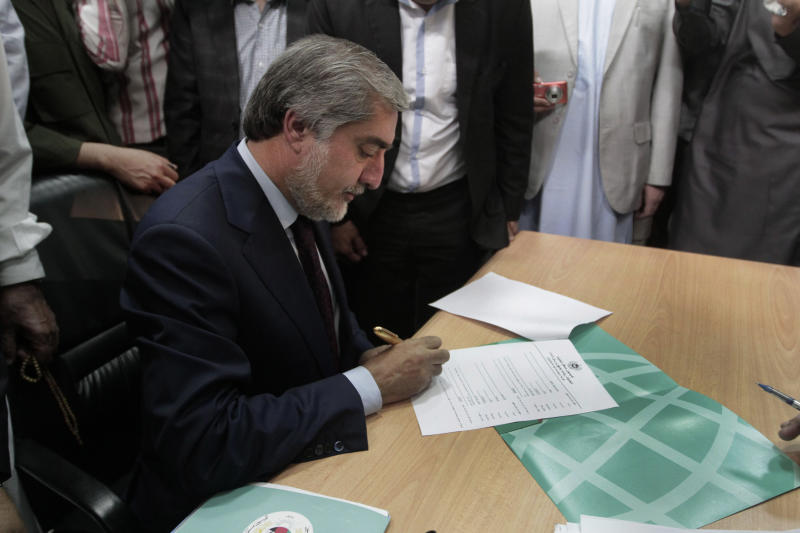 A prominent opposition leader, Abdullah Abdullah, registers his candidacy in next year's presidential election in Kabul, Afghanistan, Tuesday, Oct. 1, 2013. Next year's presidential election is a key vote that will help determine the success or failure of 12 years of U.S.-led military and political intervention in the country. (AP Photo/Rahmat Gul)