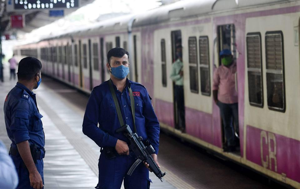 The Quick Response Team personnel keep a vigil at a railway station in Mumbai. (PTI Photo)