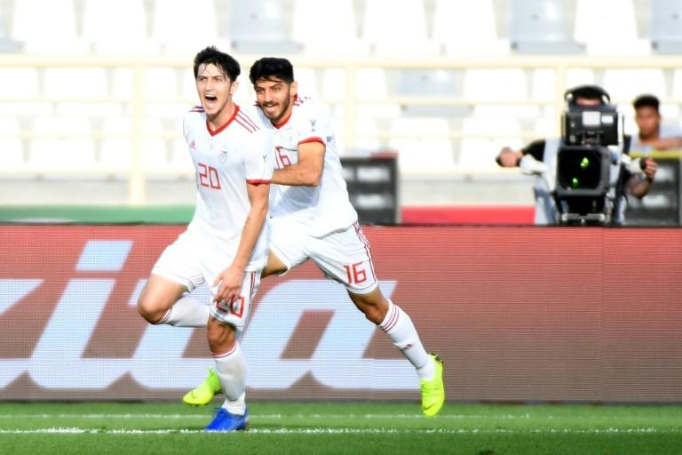Sardar Azmoun netted both goals for in-form Iran