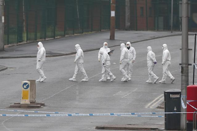 Forensic police officers at the scene of the fatal shooting of Aya Hachem, 19, in Blackburn (PA)