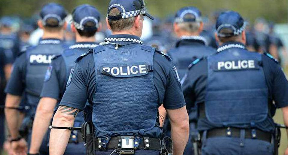 Members of the Queensland Police Service march during a capability demonstration at the Queensland Police Service Academy in Brisbane.