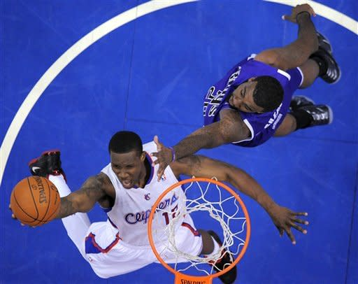 Los Angeles Clippers guard Eric Bledsoe, left, shoots as Sacramento Kings forward Donte Greene defends during the first half of their NBA basketball game, Saturday, April 7, 2012, in Los Angeles. (AP Photo/Mark J. Terrill)