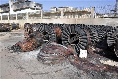 Damaged cables are seen at a factory in Sbeineh town, southern Damascus after soldiers loyal to Syria's President Bashar al-Assad, took control of it from rebel fighters last week, in this handout photograph distributed by Syria's national news agency SANA on November 15, 2013. REUTERS/SANA/Handout via Reuters
