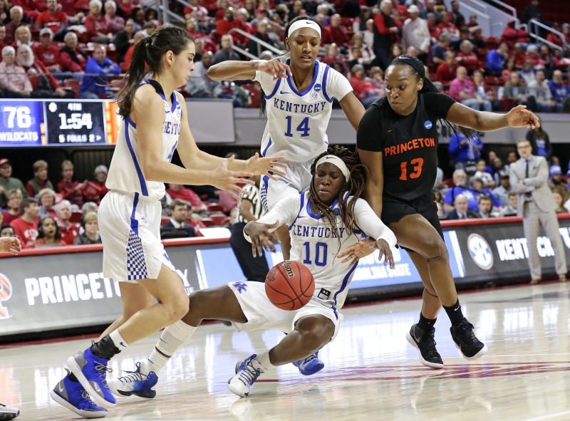 Kentucky's Maci Morris, left, Tatyana Wyatt (14) and Rhyne Howard (10) chase the ball with Princeton's Sydney Jordan (13) during the second half of a first-round game in the NCAA womens college basketball tournament in Raleigh, N.C., Saturday, March 23, 2019. Kentucky won 82-77. (AP Photo/Gerry Broome)