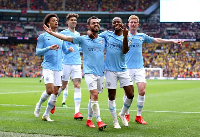 Raheem Sterling (second from right) celebrates with teammates during Manchester City's 6-0 demolition of Watford in the FA Cup final on Saturday at Wembley Stadium. (Getty)