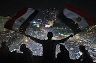 Supporters of Egyptian Armed Forces General Ahmed Fattah al-Sissi rally at Tahrir Square in Cairo, on July 26, 2013. Mass rallies by supporters and opponents of Mohamed Morsi swept Egypt, as the authorities formally detained the ousted Islamist president accusing him of conspiring with the Palestinian group Hamas