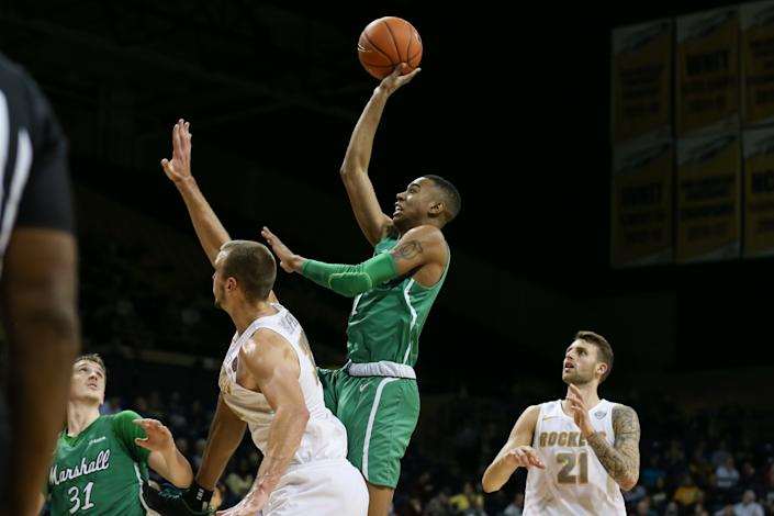 Marshall guard Taevion Kinsey shoot over Toledo center Luke Knapke (30) while guard Dylan Alderson (21) and blocks out during their game on Dec. 8, 2019. (Scott W. Grau/Icon Sportswire via Getty Images)