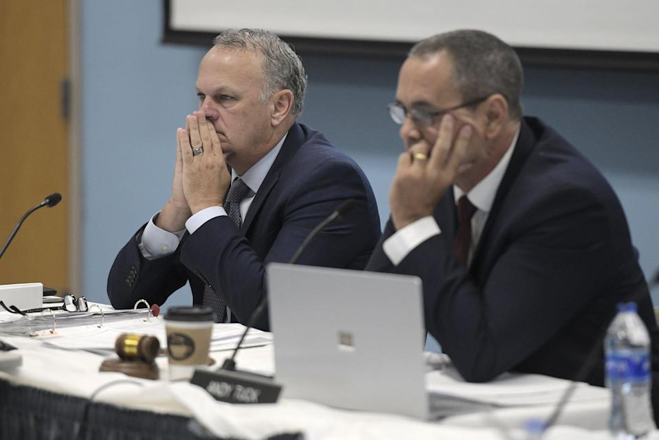 Richard Corcoran, the Commissioner of the Florida Department of Education sits next to Florida Department of Education Board Chair Andy Tuck as they listen to speakers during Thursday morning's Florida Department of Education meeting.