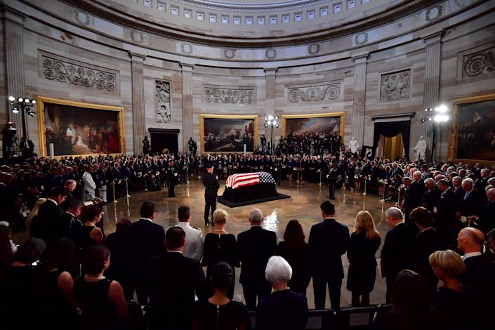 Mourners surround McCain's casket in the Capitol rotunda.