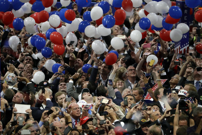 """FILE - In this July 21, 2016, file photo, confetti and balloons fall during celebrations after Republican presidential candidate Donald Trump's acceptance speech on the final day of the Republican National Convention in Cleveland. President Donald Trump demanded Monday, May 25, 2020, that North Carolina's Democratic governor sign off """"immediately"""" on allowing the Republican National Convention to move forward in August with full attendance despite the ongoing COVID-19 pandemic. Trump's tweets Monday about the RNC, planned for Charlotte, come just two days after the North Carolina recorded its largest daily increase in positive cases yet. (AP Photo/Matt Rourke, File)"""