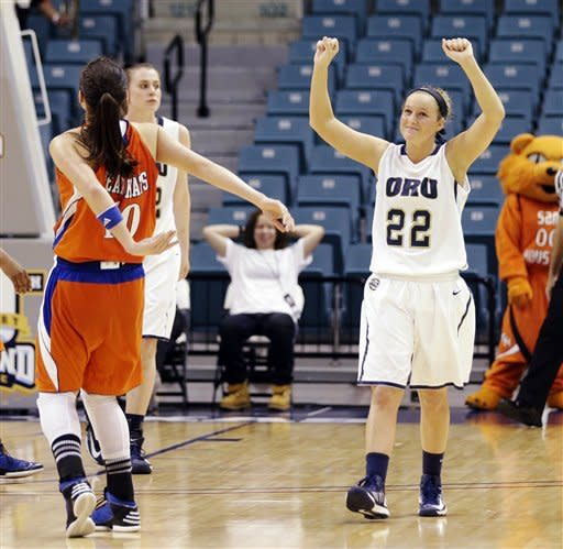 Oral Roberts' Jaci Bigham (22) celebrates their 72-66 win over Sam Houston State in the Southland Conference championship NCAA college basketball game, Saturday, March 16, 2013, in Katy, Texas. (AP Photo/David J. Phillip)