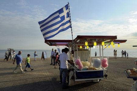 A Greek national flag is placed at a stall selling candy floss at the northern city of Thessaloniki, Greece July 1, 2015. REUTERS/Alexandros Avramidis