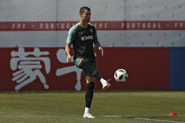 Portugal's Cristiano Ronaldo plays the ball with teammates during the training session of Portugal at the 2018 soccer World Cup in Kratovo, outskirts Moscow, Russia, Saturday, June 23, 2018. (AP Photo/Francisco Seco)