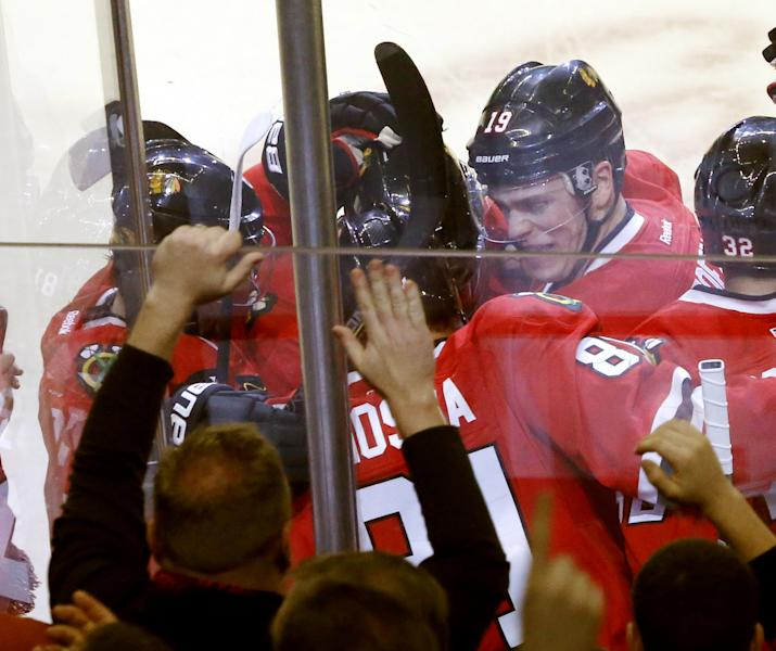 Chicago Blackhawks right wing Marian Hossa (81), of Slovakia, celebrates with teammates including Jonathan Toews (19) after scoring the winning goal during overtime of an NHL hockey game against the Edmonton Oilers, Monday, Feb. 25, 2013, in Chicago. The Blackhawks won 3-2. (AP Photo/Charles Rex Arbogast)