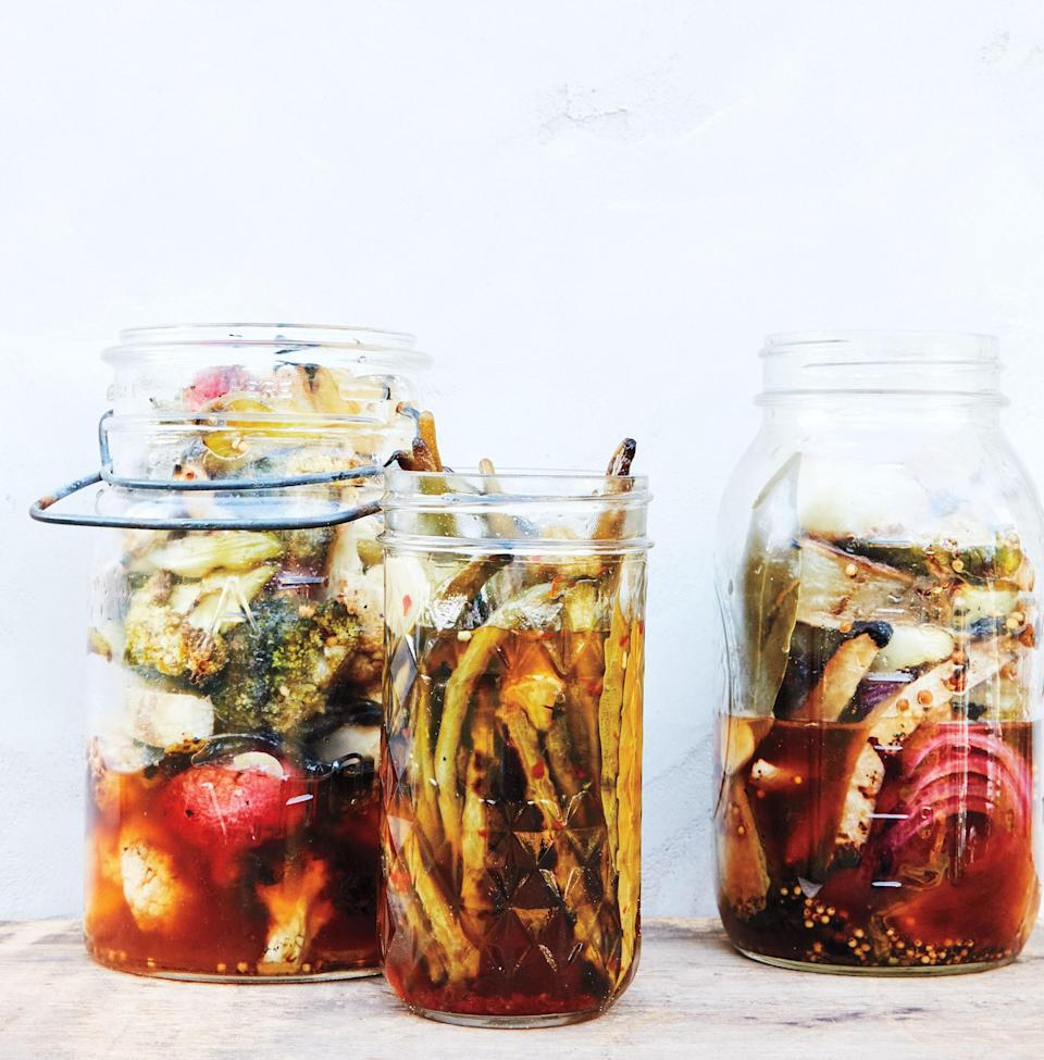 """I'm finicky about my pickles, and declare this technique nothing short of amazing. The only trick is to avoid vegetables that soften quickly, like summer squash, because they need to char but retain some crunch for the brining step. Some specifics: Cut broccoli and cauliflower into florets. Firm vegetables—like fennel, kohlrabi, daikon, onion, and jícama—should be grilled in 1/2-inch-thick slices, then cut into sticks. Cook whole green beans and okra (a real treat), but grill radishes whole or cut in half, depending on their size. Cucumbers hold up remarkably well on the grill; cut them into spears. And don't forget their cousins, melons. Carrots should be left whole, halved, or quartered so the pieces are no thicker than your pinky. <a href=""""https://www.epicurious.com/recipes/food/views/quick-pickled-charred-grilled-vegetables?mbid=synd_yahoo_rss"""" rel=""""nofollow noopener"""" target=""""_blank"""" data-ylk=""""slk:See recipe."""" class=""""link rapid-noclick-resp"""">See recipe.</a>"""