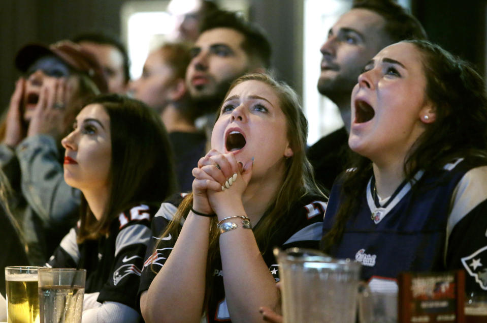 <p>Kathleen Doherty, center, of Woburn, Mass., reacts with other fans at a Boston bar while watching the New England Patriots' final drive during the first half of the NFL Super Bowl 52 football game between the Patriots and the Philadelphia Eagles in Minneapolis, Sunday, Feb. 4, 2018. (AP Photo/Steven Senne) </p>
