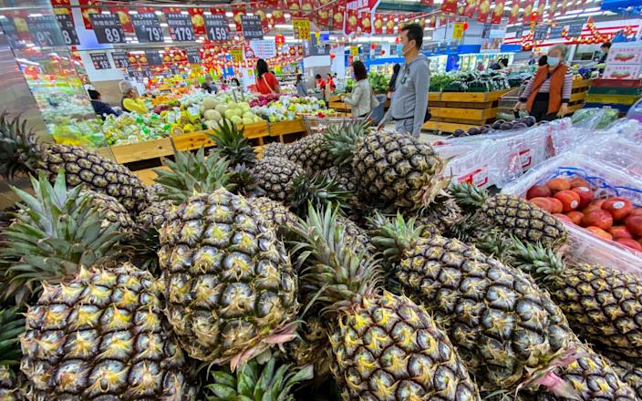 Pineapples on display at a grocery store in Taipei - RITCHIE B TONGO/EPA-EFE/Shutterstock