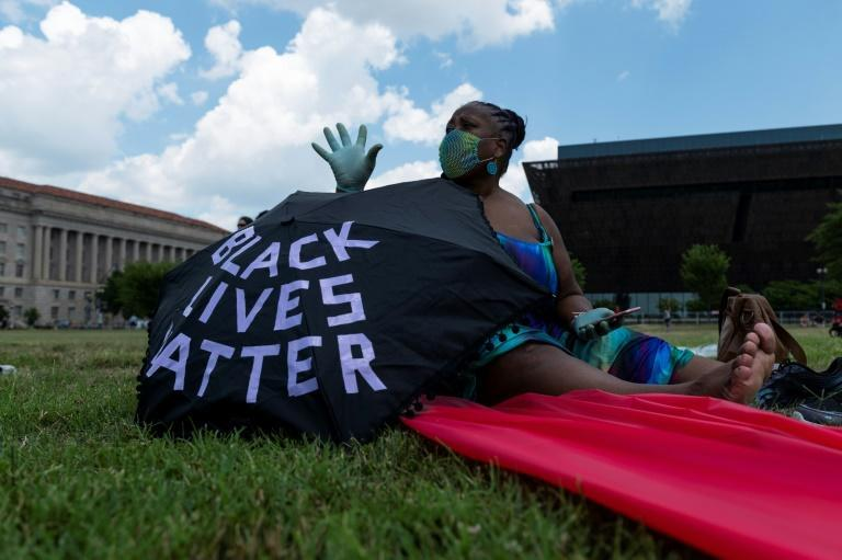 A Black Lives Matter supporter is seen in Washington on July 4 (AFP Photo/ROBERTO SCHMIDT)