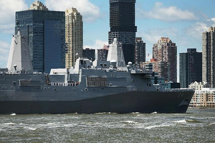 The USS Arlington (pictured May 2018), which transports marines, amphibious vehicles, conventional landing craft and rotary aircraft, will head toward the Gulf after intelligence reports suggested Iran was planning some sort of attack in the region (AFP Photo/SPENCER PLATT)