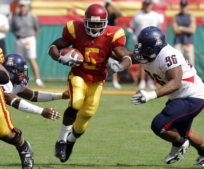 USC's Reggie Bush rushes during a game against Arizona on Oct. 8, 2005 at the Coliseum.