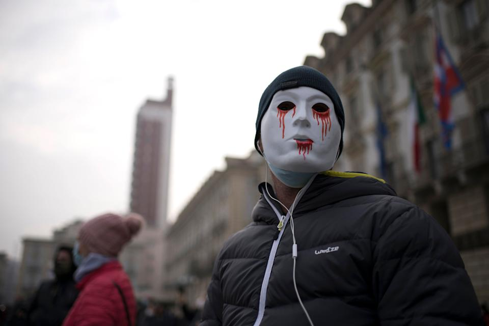 TURIN, ITALY - NOVEMBER 15:  A man wearing a mask attends the protests organized by commerciants and citizens on November 15, 2020 in Turin, Italy. In Italy, the new DPCM wanted by the Giuseppe Conte government to cope with the new phase of COVID-19 contagion, has called three zones: yellow, orange and red, depending on the health risks and the number of infected people for each region. The Piedmont Region is considered a red zone. (Photo by Stefano Guidi/Getty Images) (Photo: Stefano Guidi via Getty Images)