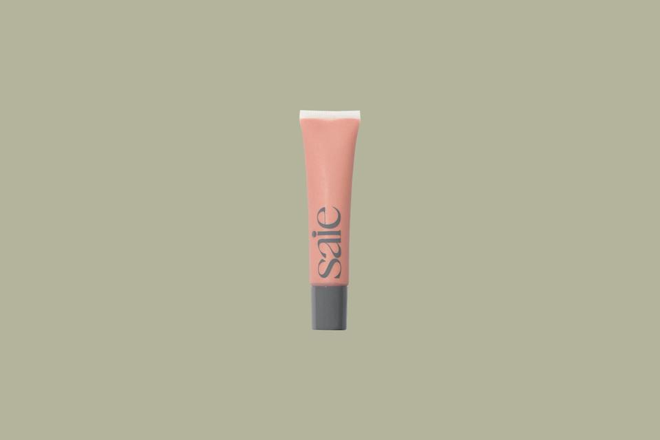"""<p>With packaging made from post-consumer recycled plastic, a tube of Saie Beauty's lip balm-gloss hybrid will add a touch of color and a bit of moisture to your lips. The product is made from <a href=""""https://www.marthastewart.com/1541521/best-natural-beauty-products"""" rel=""""nofollow noopener"""" target=""""_blank"""" data-ylk=""""slk:clean ingredients only"""" class=""""link rapid-noclick-resp"""">clean ingredients only</a>, like beeswax, squalene, and coconut oil; there is no petroleum, a known carcinogen, in the formula.</p> <p><strong><em>Shop Now: </em></strong><em>Saie Beauty Liquid Lip Balm, $16, </em><a href=""""https://saiehello.com/products/liquid-lip-balm?variant=32149599256636"""" rel=""""nofollow noopener"""" target=""""_blank"""" data-ylk=""""slk:saiehello.com"""" class=""""link rapid-noclick-resp""""><em>saiehello.com</em></a><em>.</em></p>"""