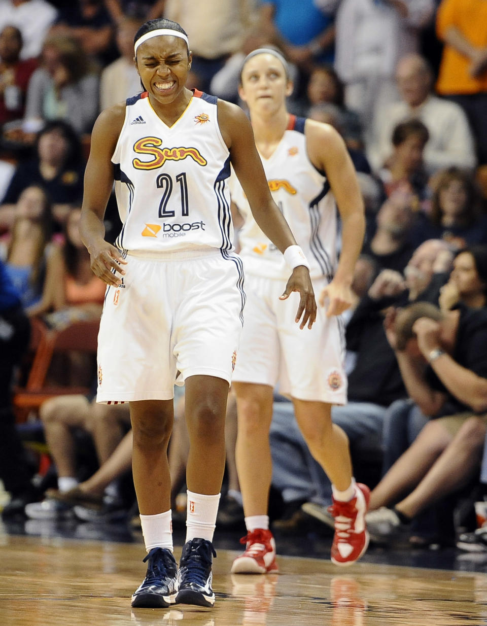 Connecticut Sun's Renee Montgomery reacts after missing a shot at the buzzer during the second half of a WNBA basketball game against the Los Angeles Sparks in Uncasville, Conn., Tuesday, Aug. 6, 2013. The Sparks won 74-72. (AP Photo/Jessica Hill)