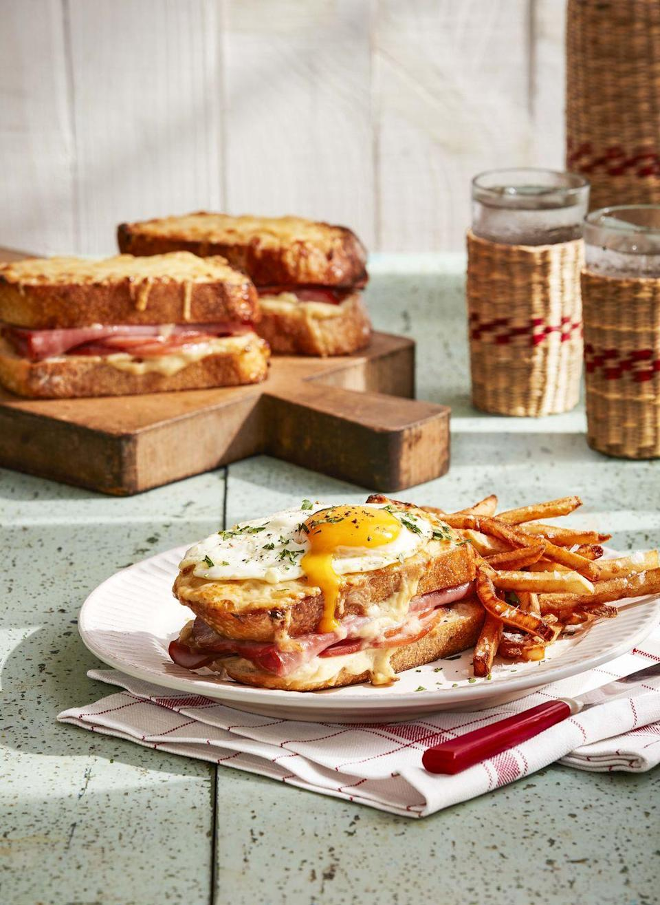 """<p>Possibly the ultimate combination of eggy breakfast and sandwichy lunch, this brunch special is always a treat.</p><p><strong><a href=""""https://www.countryliving.com/food-drinks/a32042684/croque-madames/"""" rel=""""nofollow noopener"""" target=""""_blank"""" data-ylk=""""slk:Get the recipe"""" class=""""link rapid-noclick-resp"""">Get the recipe</a>.</strong></p><p><strong><a class=""""link rapid-noclick-resp"""" href=""""https://www.amazon.com/Victoria-Skillet-Seasoned-Flaxseed-Certified/dp/B01726HD72/?tag=syn-yahoo-20&ascsubtag=%5Bartid%7C10050.g.34822192%5Bsrc%7Cyahoo-us"""" rel=""""nofollow noopener"""" target=""""_blank"""" data-ylk=""""slk:SHOP SKILLETS"""">SHOP SKILLETS</a><br></strong></p>"""
