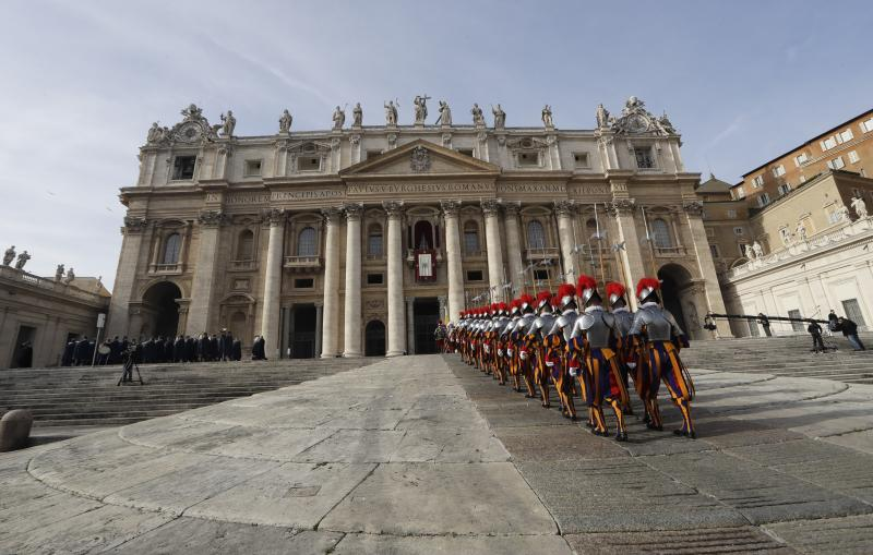 """FILE - In this Sunday, Dec. 25, 2016. file photo, Swiss Guards march in front of Peter's Basilica at the Vatican. The head of the Swiss Guards says the elite corps that protects the pope and the Vatican is ready to confront any terror attacks, following renewed threats against Rome by supporters of the Islamic State group following the Barcelona attack. Commander Christoph Graf told Swiss Catholic website cath.ch this week that """"perhaps it is only a question of time before an attack like that happens in Rome. But we are ready also for this."""" (AP Photo/Alessandra Tarantino, File)"""