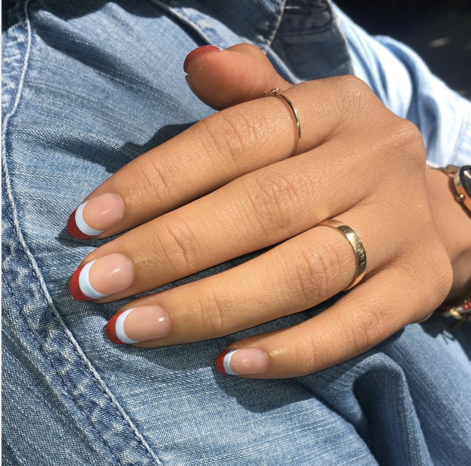"""<p>Go for a twist on a classic style with a French manicure in two patriotic colors. Light blue makes this look even more wearable.</p><p><a class=""""link rapid-noclick-resp"""" href=""""https://www.amazon.com/Orly-Half-Moon-Guides-Count/dp/B00FMVR802/?tag=syn-yahoo-20&ascsubtag=%5Bartid%7C10055.g.1278%5Bsrc%7Cyahoo-us"""" rel=""""nofollow noopener"""" target=""""_blank"""" data-ylk=""""slk:SHOP GUIDE TAPE"""">SHOP GUIDE TAPE</a></p>"""