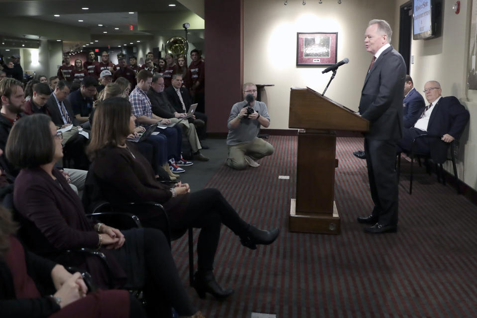 Bobby Petrino speaks after being introduced as the new NCAA college football head coach at Missouri State as his wife Becky, seated second from left, listens during a news conference Thursday, Jan. 16, 2020, in Springfield, Mo. Petrino has a 119-56 record in 14 seasons at Arkansas, Western Kentucky and Louisville and replaces Dave Steckel who was fired after winning just 13 games in five seasons. (AP Photo/Jeff Roberson)