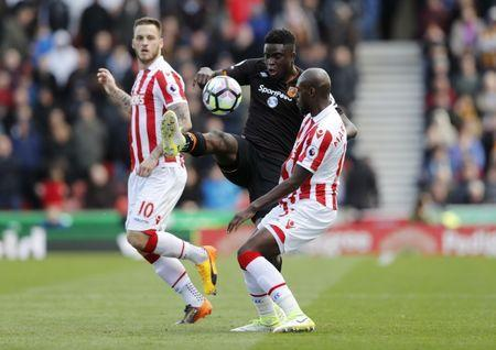 Britain Soccer Football - Stoke City v Hull City - Premier League - bet365 Stadium - 15/4/17 Hull City's Alfred N'Diaye in action with Stoke City's Bruno Martins Indi and Marko Arnautovic Action Images via Reuters / Carl Recine Livepic