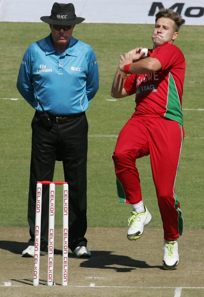 Zimbabwe's Kyle Jarvis bowls during the first match of the five match ODI cricket series between India and hosts Zimbabwe at the Harare Sports Club on  July 24, 2013. AFP PHOTO /Jekesai Njikizana.        (Photo credit should read JEKESAI NJIKIZANA/AFP/Getty Images)