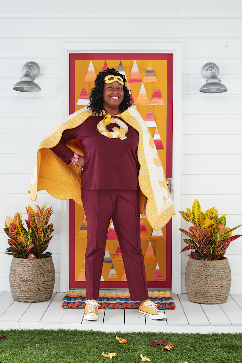 """<p>Quilters (and knitters, and crocheters!), unite! This fun costume will help you save the day—or, at the very least, the """"crafter-noon."""" And you can show off your handiwork while you're at it!</p><p><strong>Make the Costume: </strong>Cut a quilt into a trapezoid shape; sew a corresponding color bias tape around the edges to finish. At the top corner of the trapezoid, sew a correspond- ing color ribbon for ties. Use a scrap of the quilt to cut out an oversize letter """"Q"""" and blanket stitch it to the front of a T-shirt. Blanket stitch around the edges of a <a href=""""https://www.amazon.com/DANGSHAN-Superhero-Masquerade-Halloween-Multicolor/dp/B071F8D3BH?tag=syn-yahoo-20&ascsubtag=%5Bartid%7C10050.g.23785711%5Bsrc%7Cyahoo-us"""" rel=""""nofollow noopener"""" target=""""_blank"""" data-ylk=""""slk:felt superhero mask"""" class=""""link rapid-noclick-resp"""">felt superhero mask</a> and round out the look with a tailor tape measure bracelet adorned with sewing charms. Glue a metal thimble to a silver ring blank to create a superpower ring.</p><p><a class=""""link rapid-noclick-resp"""" href=""""https://www.amazon.com/Superhero-Cosplay-Halloween-Christmas-Birthday/dp/B07MFH66JB/ref=sr_1_3?tag=syn-yahoo-20&ascsubtag=%5Bartid%7C10050.g.23785711%5Bsrc%7Cyahoo-us"""" rel=""""nofollow noopener"""" target=""""_blank"""" data-ylk=""""slk:SHOP FELT SUPERHERO MASKS"""">SHOP FELT SUPERHERO MASKS</a></p>"""