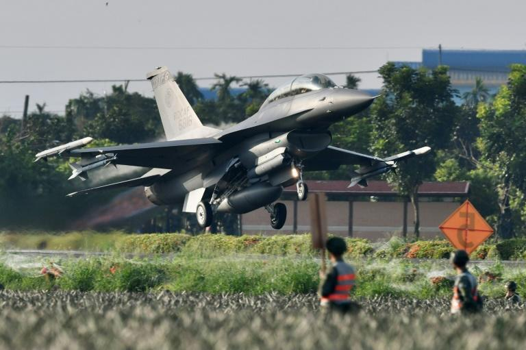 A US-made F16 fighter jet takes off from a motorway in Pingtung, southern Taiwan (AFP/Sam Yeh)