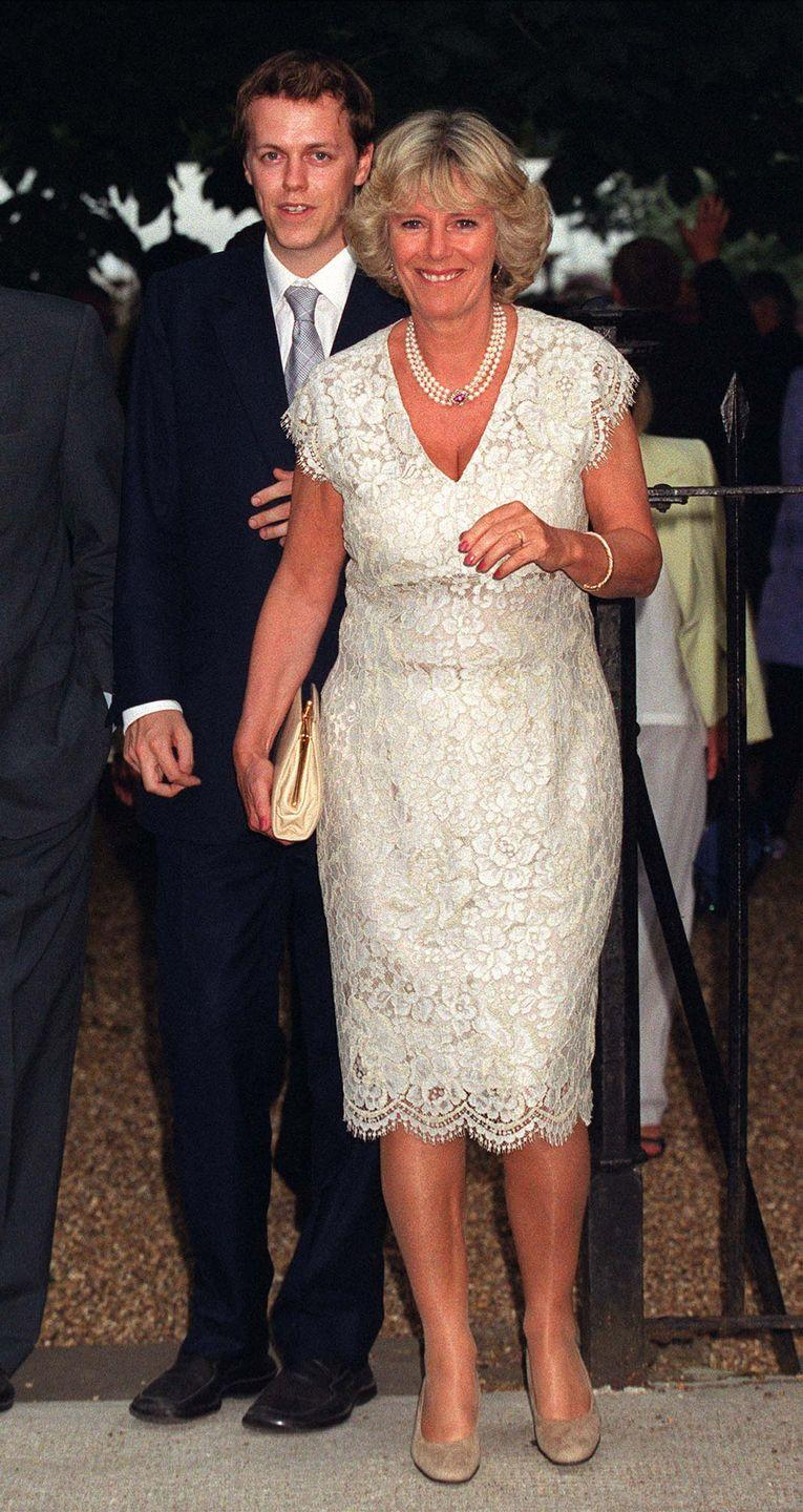 <p>Camilla donned this summery look for a seasonal party in Chelsea, London. The knee-length cream lace dress featured cap sleeves, which Camilla added extra sophistication to with a three-strand pearl necklace. </p>