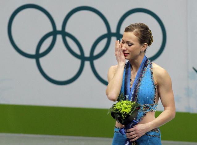 <p>Merely days after losing her mother to a sudden heart attack, Canadian figure skater Joannie Rochette took to the ice at the 2010 Vancouver Games and not only completed her routine, but won bronze. She dedicated the medal to her mother. (AP) </p>