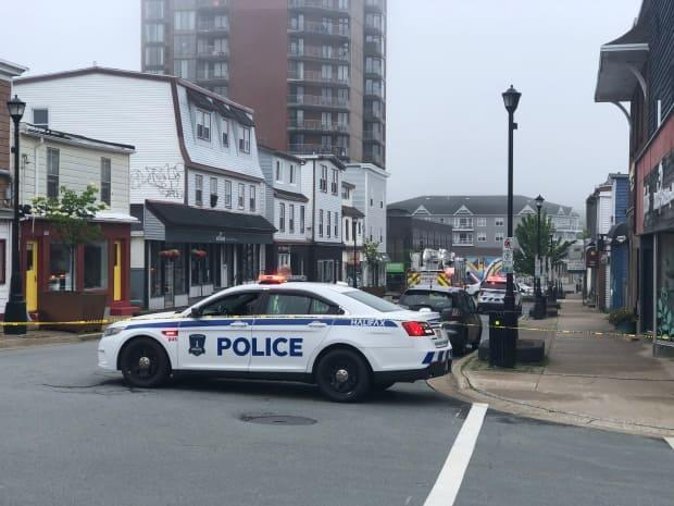 This image shows an area of Portland Street in downtown Dartmouth blocked off with police tape on June 26, 2021. (Jean Laroche/CBC - image credit)