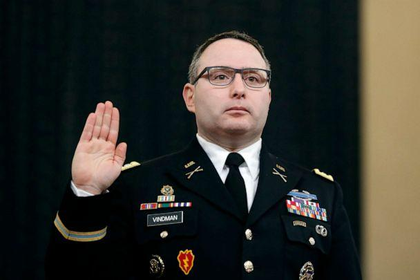 PHOTO: National Security Council aide Lt. Col. Alexander Vindman is sworn in to testify before the House Intelligence Committee on Capitol Hill in Washington during a public impeachment hearing of President Donald Trump. (Andrew Harnik/AP, FILE)