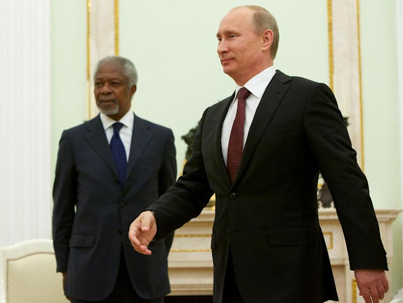 Russian President Vladimir Putin, right, walks as United Nations special envoy Kofi Annan looks on before their talks in Moscow, Tuesday, July 17, 2012. The UN and Arab League envoy to the Syrian crisis has begun his meeting with the Russian president by saying that Syria is at a crossroads, as violence escalates. (AP Photo/Alexander Zemlianichenko)