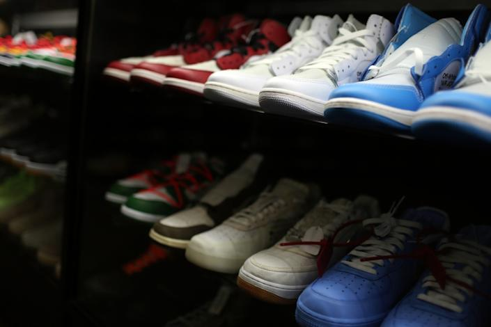 """Some sneakers in a glass case at CoolKicks are priced at $5,000. <span class=""""copyright"""">(Dania Maxwell / Los Angeles Times)</span>"""