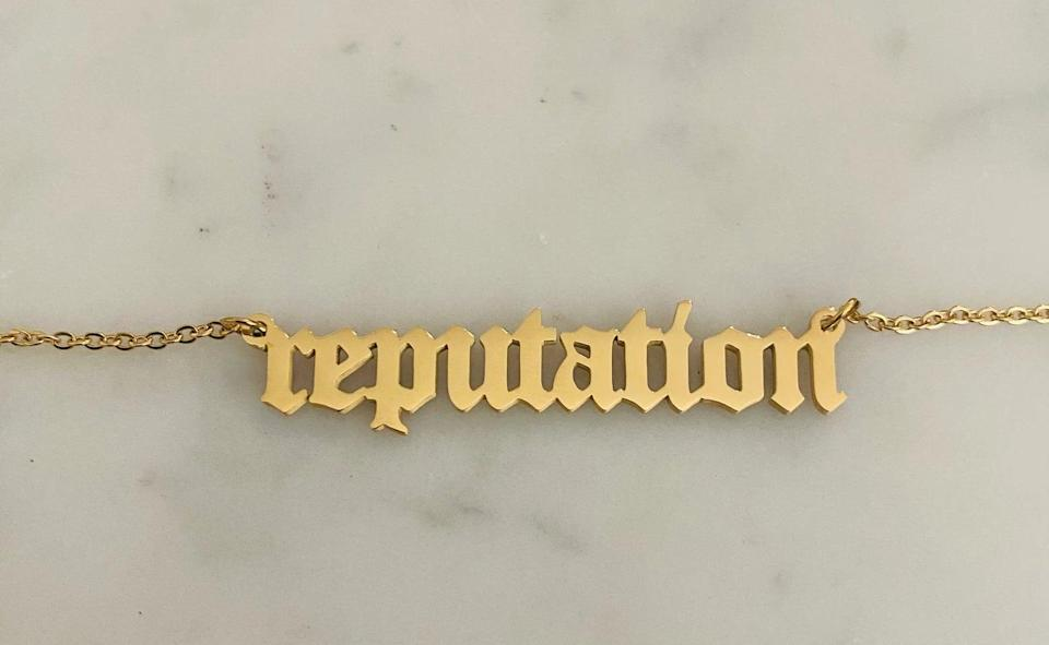 <p>If you're shopping for the Swiftie currently in their <b>Reputation</b>-inspired era, they'll obsess over this <span><b>Reputation</b> Gold-Toned Stainless Steel Necklace</span> ($25). The stylish necklace is perfect for layering as well. </p>