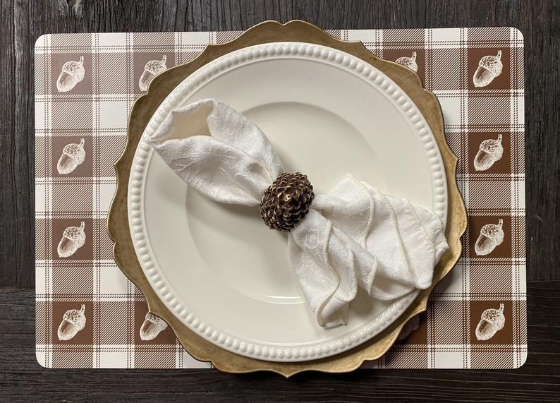 "<p>From preparing the <a href=""https://www.countryliving.com/food-drinks/g33220825/thanksgiving-appetizers/"" rel=""nofollow noopener"" target=""_blank"" data-ylk=""slk:Thanksgiving appetizers"" class=""link rapid-noclick-resp"">Thanksgiving appetizers</a> to the <a href=""https://www.countryliving.com/food-drinks/g1365/turkey-recipes/"" rel=""nofollow noopener"" target=""_blank"" data-ylk=""slk:turkey recipe"" class=""link rapid-noclick-resp"">turkey recipe</a> to the delectable <a href=""https://www.countryliving.com/food-drinks/g1384/thanksgiving-desserts/"" rel=""nofollow noopener"" target=""_blank"" data-ylk=""slk:Thanksgiving desserts"" class=""link rapid-noclick-resp"">Thanksgiving desserts</a>, you'll be plenty busy cooking up a storm on Turkey Day. While setting the table is one more task to check off your to-do list, it doesn't have to be a chore! Get excited about the holiday by decorating your table in style. You even set up your <a href=""http://www.countryliving.com/entertaining/g634/thanksgiving-table-settings-1108/"" rel=""nofollow noopener"" target=""_blank"" data-ylk=""slk:Thanksgiving table setting"" class=""link rapid-noclick-resp"">Thanksgiving table setting</a> ahead of time, such as the night before, so it's one less thing to manage on the big day. From natural fibers to woven textures and pretty paper placemats you can toss after dinner to save yourself some work, we've got plenty of versatile options you can shop now. Many of these fun and colorful choices can be enjoyed all season long, not just on Turkey Day, because they boast fall motifs you can enjoy for weeks. And if the little ones are coming, opt for activity placemats that double as <a href=""http://www.countryliving.com/diy-crafts/g22626432/thanksgiving-crafts-for-kids/"" rel=""nofollow noopener"" target=""_blank"" data-ylk=""slk:Thanksgiving crafts for kids"" class=""link rapid-noclick-resp"">Thanksgiving crafts for kids</a> to keep them busy while you work. On the other hand, kids of all ages just may enjoy a little coloring session! </p><p>Here are our top picks for placemats that will finish your Thanksgiving table decor in style.</p>"