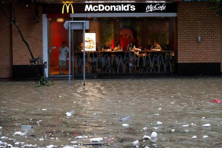 A flooded street is seen outside a McDonalds restaurant as Typhoon Hato hits Hong Kong, China August 23, 2017. REUTERS/Tyrone Siu