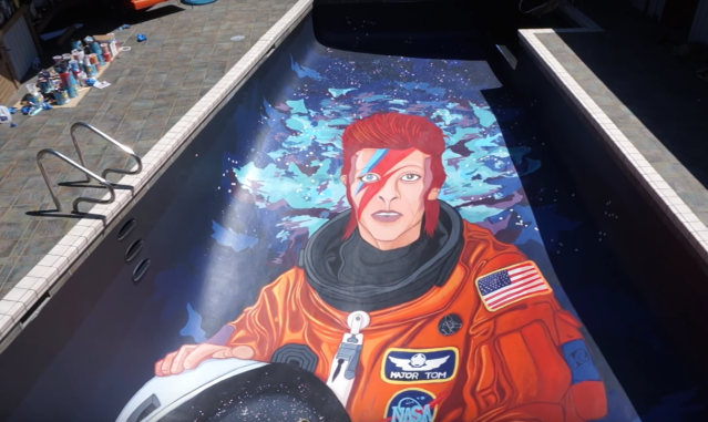 You need to see this video of a David Bowie mural being painted…in a swimming pool