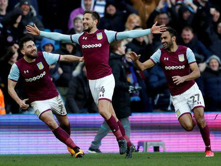 Soccer Football - Championship - Aston Villa vs Birmingham City - VIlla Park, Birmingham, Britain - February 11, 2018 Aston Villa's Conor Hourihane celebrates with Robert Snodgrass and Ahmed Elmohamady after scoring their second goal Action Images/Andrew Boyers