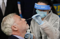 Metropolitan Transportation Authority chairman and CEO Patrick Foye gets a Covid test after a news conference to announce plans for the testing of its workers Tuesday, Oct. 27, 2020, at the Grand Avenue Bus Depot in New York. (AP Photo/Frank Franklin II)
